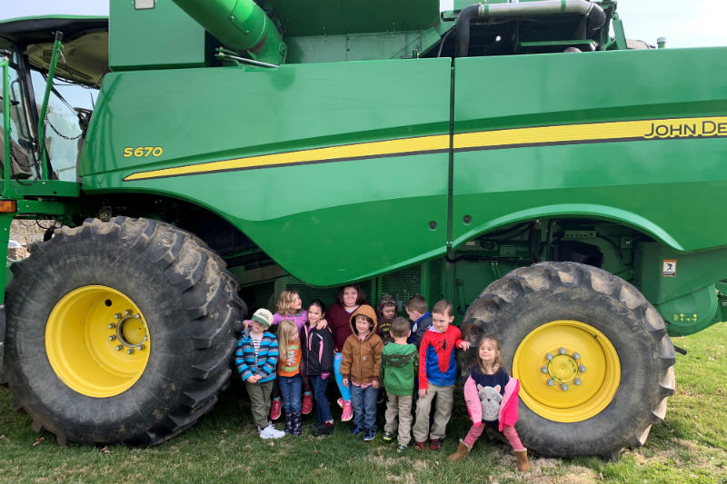 Effinger PreSchool Rockbridge kids with farm equipment