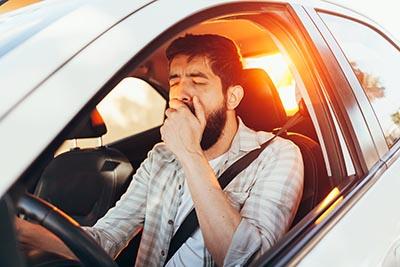 yawn tired car man business